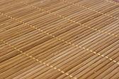 Bakgrunden bambu pinnar med tråd förenar — Stockfoto