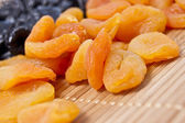 Background from a dried apricots and prunes — Stock Photo