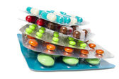 Heap of assorted pill packages — Stock Photo