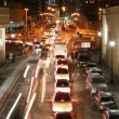 Traffic in the night city with motion blur — Stock Photo