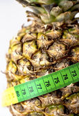 Pineapple with measure tape — Stock Photo