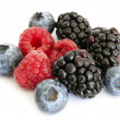 Blueberry, blackberry and raspberry on the white background — Стоковая фотография