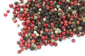 Peppercorns on the white background — Stock Photo