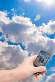 Smartphone in Hand - Weather Forecast — Stock Photo