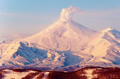 Volcano covered with snow — Stock Photo
