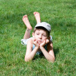 Stock Photo: Boy of five years lays on grass