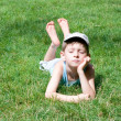 Boy of five years lays on grass — Stock Photo #6259808
