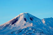 Volcano covered with snow in Russia — Stock Photo