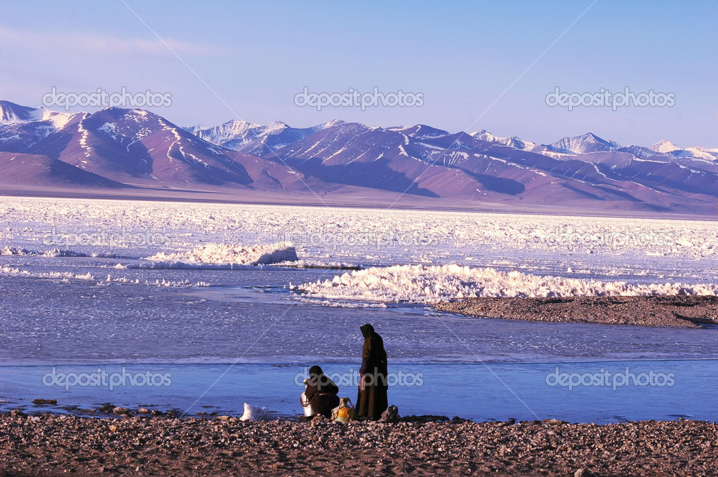 Landscape of snow-capped mountains and frozen lake in winter  Stock Photo #5421392