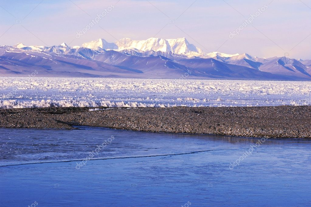 Landscape of snow-capped mountains and frozen lake in winter  Stock Photo #5421403