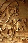 Brick carvings of lotus — Stock Photo