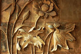 Ancient brick carving art of lotus flowers — Stock Photo