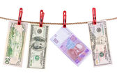 American and Ukrainian currencies is dry on the rope. — Stock Photo