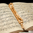 Stock Photo: Koran book and rosary.