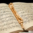 Koran book and rosary. — Stock Photo