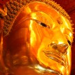 Stock Photo: The Golden Buddha Face of Phananchoeng Temple