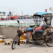 Old Tricycle in Harbour and Ocean Liner — Stock Photo