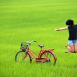 Happy girl jumping in paddy field — Stock Photo #5909399