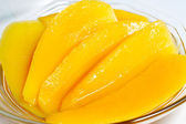 Sweet dessert: Mango slice in syrup — Stock Photo