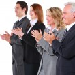 Businessman and businesswoman applauding — Foto Stock