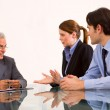 Two men and one woman during a job interview — Stock Photo #6035343