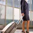 Stock Photo: Businesswoman with trolley