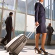 Businesswoman with trolley - Stock Photo