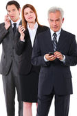 Two businessman and one businesswoman with mobile — Stok fotoğraf