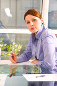 One woman in office at the desk — Stock Photo