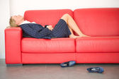 Exhausted businesswoman lying on the couch — Stock Photo