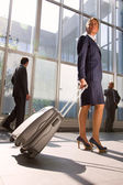 Businesswoman with trolley — Stock Photo