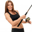 Sport woman holding a fishing rod with reel — Stock Photo