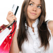 Woman standing, holding credit card and shopping bags in hand — Lizenzfreies Foto