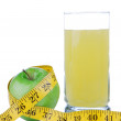 Diet weight  with tape measure organic green apple juice — Stock Photo