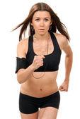 Slim брюнетка Спорт женщина бег трусцой и бег, слушая музы — Стоковое фото