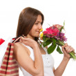 Royalty-Free Stock Photo: Woman holding shopping bags, presents and bouquet of flowers