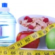 Diet weight loss concept with tape measure red apple — Stock Photo