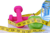 Diet diabetes concept with tape measure organic green apple — Stock Photo