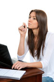 Pretty businesswoman thinking, with laptop on the table — Stock Photo