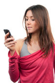 Pretty woman reading, typing and sending SMS text message on mob — Stock Photo