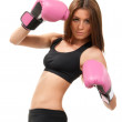Beautiful young woman boxing pose in Pink gloves — Stock Photo