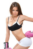 Young slim sexy woman boxing pink gloves posing — Stockfoto