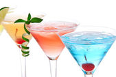 Martini alcohol cocktails in row blue hawaiian, tequila sunrise — Stock Photo