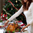 Christmas roasted turkey in young beautiful woman hands — ストック写真