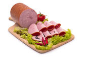 Delicious sausages, served on platter, decorated with vegetables — Stock Photo