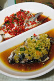 Steamed Fish head with diced hot red peppers — Stock Photo