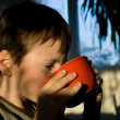 Boy at breakfast - Stock Photo