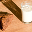 Milk and brownie — Stock Photo