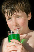 Young boy drinking a mint water — Stock Photo
