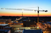 Crane over a Town at Twilight — Stock Photo